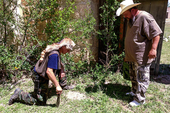 Turtleman and Neal investigate the property surrounding the Alamo Village for potential clues.