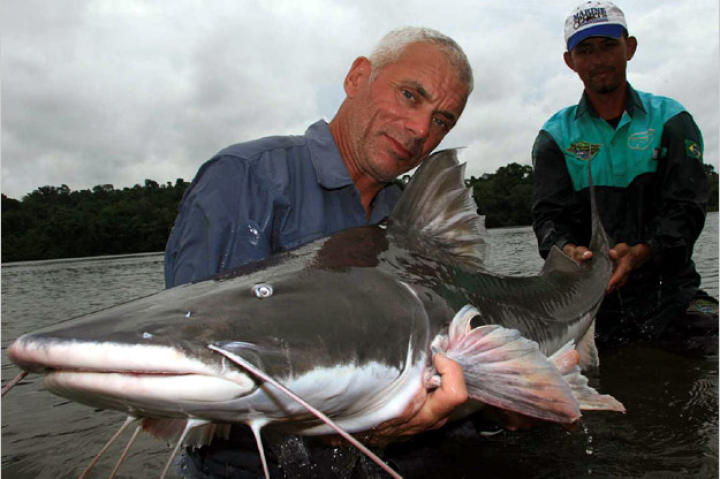 Jeremy Wade holds a 72-pound, 5-foot-long piraiba catfish. These formidable fish can grow to over 10 feet in length and 600 pounds in weight.