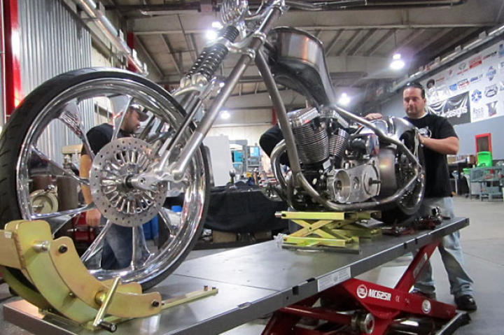 Joe Puliafico helps Paulie with the FIST bike's fender. With its reverse curves, biometric readers, front-end configurations and 26-inch wheels, the FIST Bike was a complicated build.