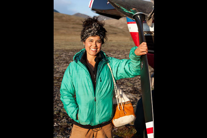 Ariel works with her parents and sister at their family-run airline, Era Alaska. Here she is standing next to the Cessna 180, an aircraft model dating back to the 1950's.