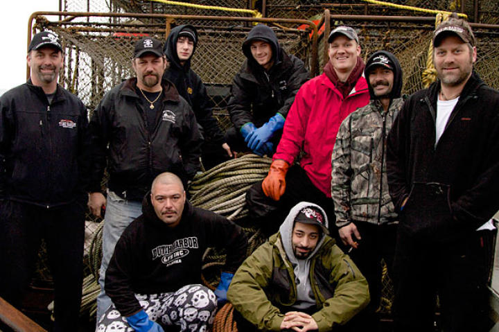 "The Time Bandit's crew this season includes, from left to right, back row: Captain Andy Hillstrand, Captain Jonathan Hillstrand, Eddie Uwekoolani, Jr., Scott Hillstrand, Mike Fourtner, Neal Hillstrand and Travis Lofland. Foreground, left to right: Eddie Uwekoolani and Josh Harris.  Like his brother Jake on the Northwestern, Josh Harris takes a spot on the Time Bandit when it becomes clear that the Cornelia Marie will sit out this season. Eddie Junior proved his worth and toughness last season and is back as a second-year greenhorn. Fun-loving Travis Lofland returns for a second year, gladder than ever that he decided to become a ""Bandit"" rather than return to the Wizard."