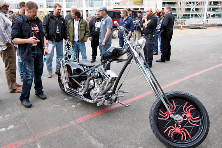"""The captains, including """"Wild"""" Bill Wichrowski, Elliot Neese, Johnathan Hillstrand (with Rick Petko) and Sig Hansen, check out OCC's Deadliest Catch Bike."""