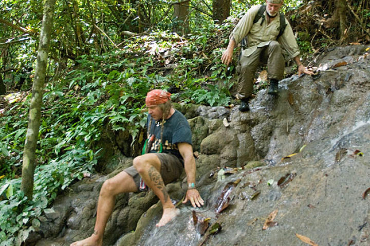 Cody and Dave prepare to set out on their Thai rain forest adventure that begins in rugged highlands covered with jagged limestone formations. In this scenario, the pair take on the situation of  ill-equipped eco-tourists lost in a unforgiving landscape with just a Thai jungle knife, steel wool, a sharpening stone, a damaged cell phone and a bag of tobacco.