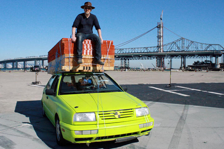 Adam Savage perches atop the Lumber Car, which he and Jamie used to test whether a do-it-yourselfer really could have loaded his vehicle with 3,100 pounds of building materials — and then drive home.