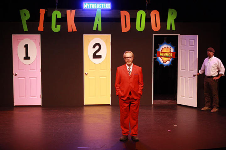 I can't write a caption for this photo, are you kidding me? Look at that saucy red suit! Clearly, this photo is from the Monty Hall Paradox shoot ... and Adam Savage looks fetching in red.