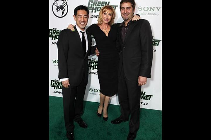 Grant Imahara, Kari Byron and Tory Belleci pose for pictures on the green carpet.