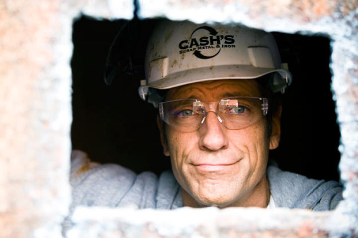 Mike Rowe peers out at the lucky photographer from the barge he was helping to demolish in St. Louis.