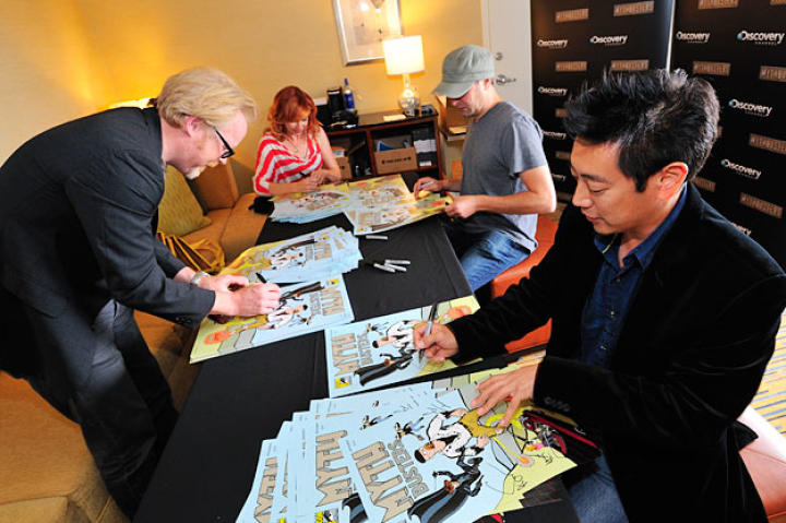 Adam Savage, Kari Byron, Tory Belleci and Grant Imahara sign the limited-edition MythBusters Comic Con poster before their panel.