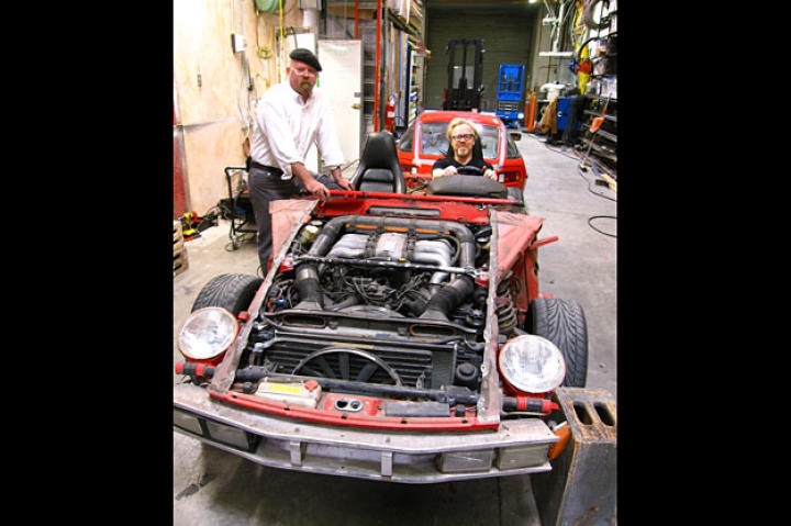"""For """"Reverse Engineering,"""" Jamie Hyneman and Adam Savage flip the body of a 1970s sports car to see if its design really did make it go faster backward than forward."""
