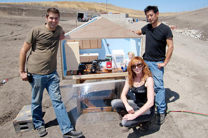 "Tory Belleci, Kari Byron and Grant Imahara show off the miniature kitchen they used in the ""Gas Room Boom"" tests."