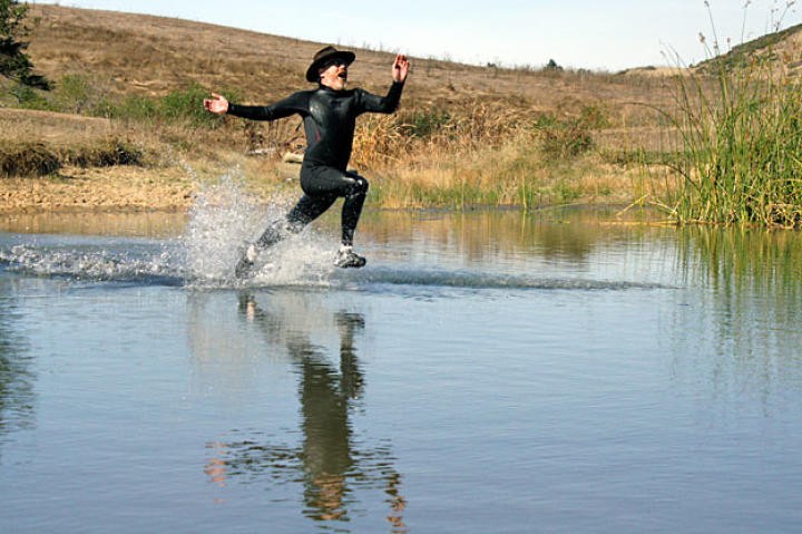 """Taking on another viral video, Adam Savage tries his foot at """"Liquid Mountaineering"""" (in other words ... walking on water)."""