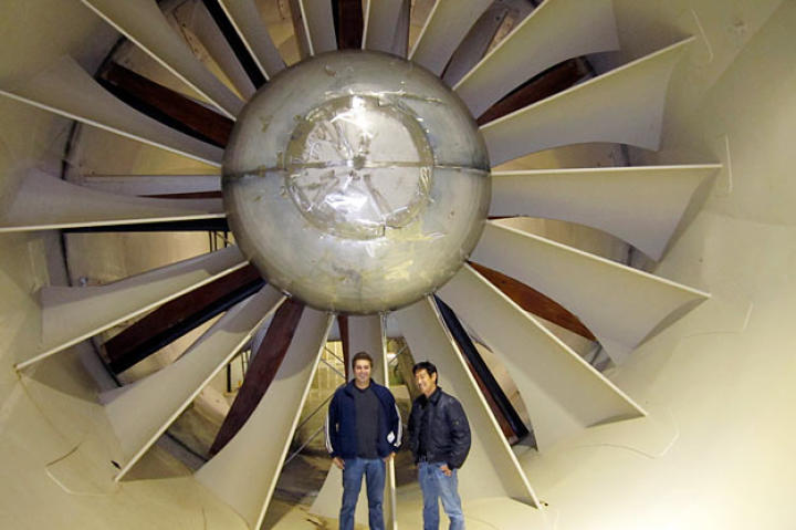 "Tory Belleci and Grant Imahara pose in front of NASA's icing research tunnel during the testing of the ""Blue Ice"" myth. (Yes, we said ""icing research tunnel."" It's used to develop, test, and certify methods to prevent ice buildup on aircraft, so it's really, really important as well as cool-looking.)"