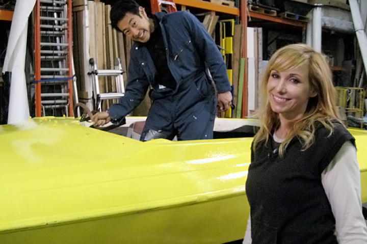 "Grant Imahara and Kari Byron pose with what will be their substitute super-fast fish for ""Flaming Reel."""