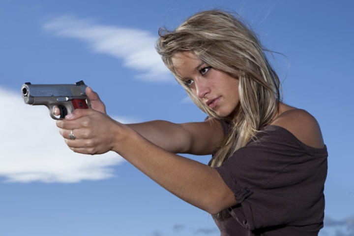 Paige takes aim with the Defender, a lighter, more compact model of the classic .45 that's her preferred personal sidearm.