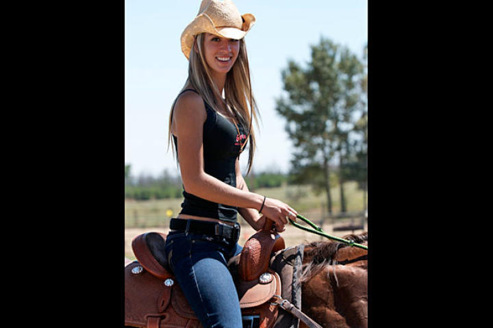 Just as natural as her love of firearms, Paige takes to horseback riding as an essential part of life out West.