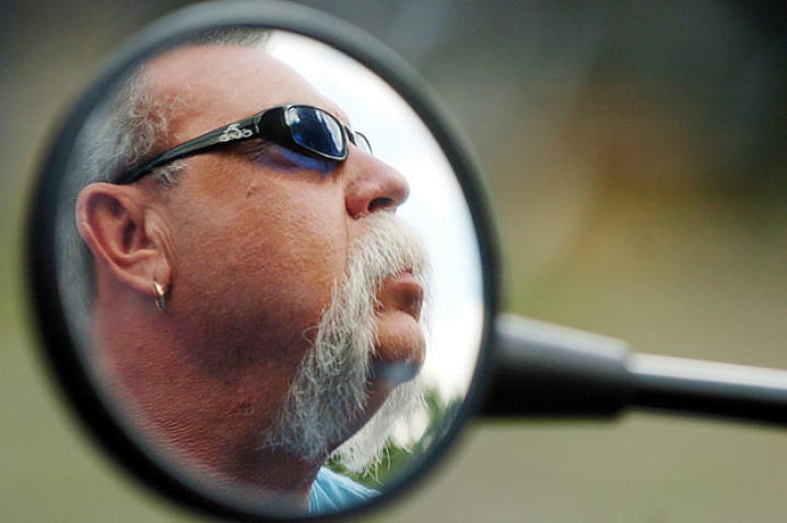 Paul Teutul Sr. as reflected in his side-view mirror in 2005.