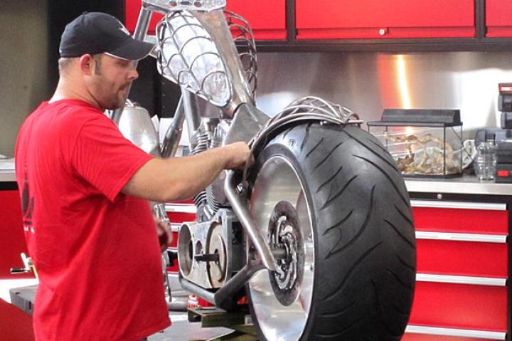 Paul Teutul Jr. works on the PJD Bike, a spider-web-themed chopper.
