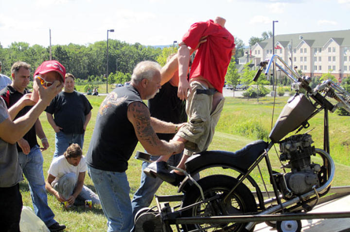 Paul Sr. and the Orange County Choppers crew prepare to launch a dummy dressed as Junior over a creek.
