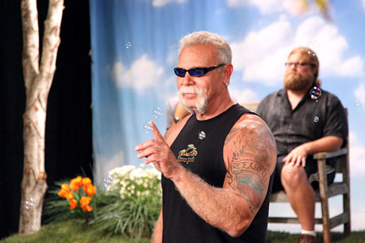 Paul Teutul Sr. faces off against bubbles as Mikey relaxes in the background (July 2009).