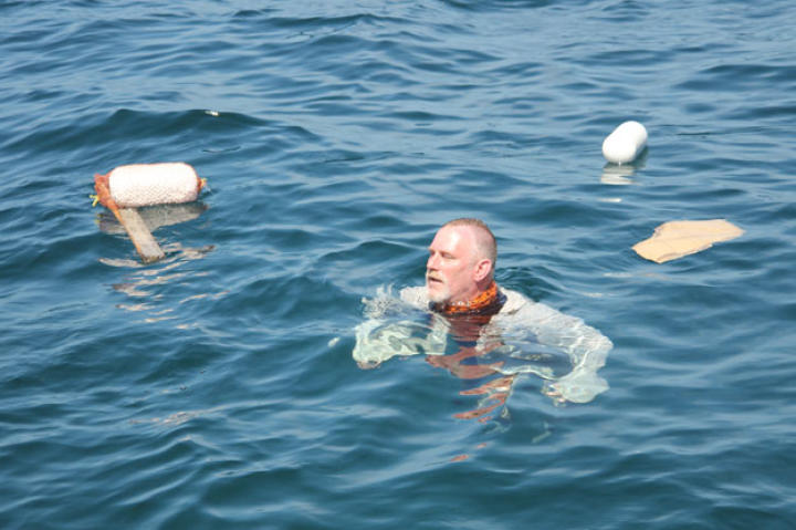 At the start of the shipwreck scenario Dave stays in the water to demonstrate the options for flotation devices and methods. With his extensive military training, Dave has the most experience in the challenges of water survival.
