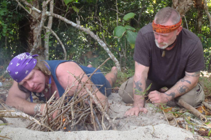 """Once ashore, the first priorities always include fire, especially on a remote island where smoke can also serve as a signaling tool. One challenge in this environment is the lack of """"sticks"""" for friction fire methods, but Cody is able to make a few expert adjustments so otherwise smooth bamboo will work."""