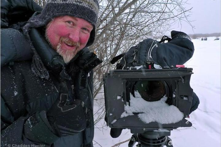 Filming bison and wolves in the Canadian High Arctic.