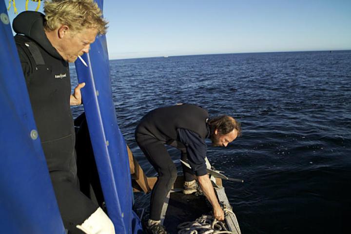 Boss Scott Meisterheim keeps a wary eye on Steve Riedel as he drops anchor.