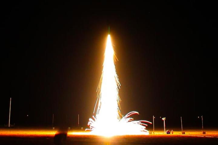 Here's an amazing still photo of a night-time rocket launch.