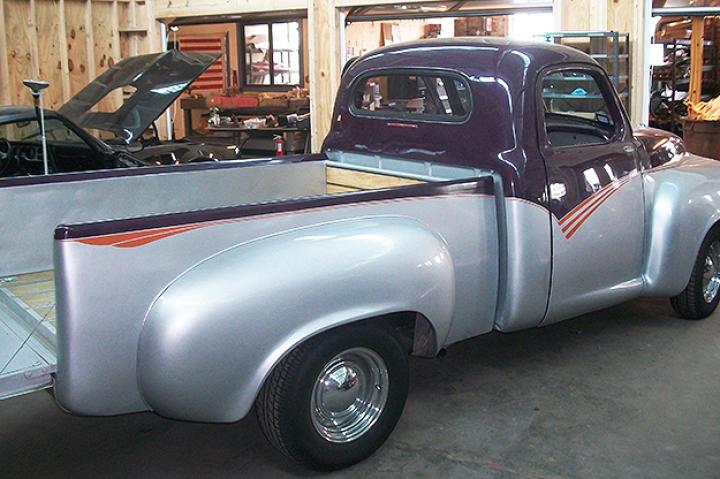 The Studebaker arrives rear passenger side, tail get down.