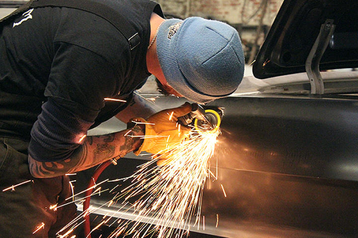 Walter working on the Impala.
