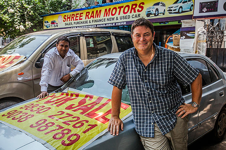 Mike Brewer posing with local car expert Chak.