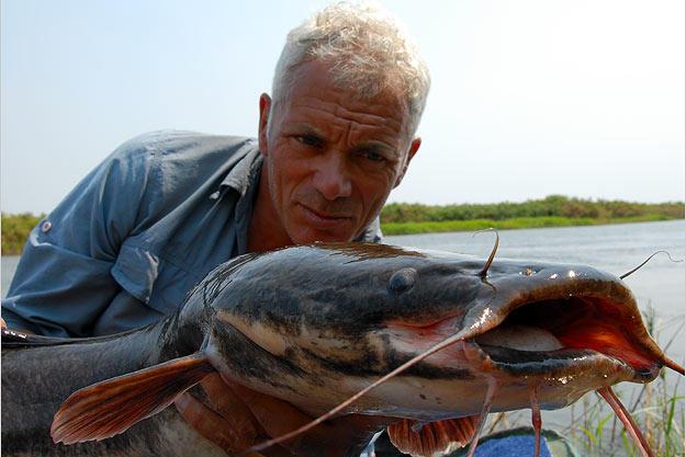 Jeremy Wade holds a blue catfish.