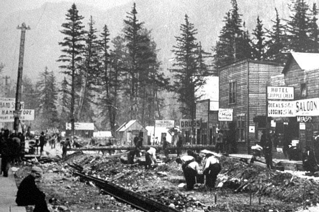 Within weeks after news of the Klondike gold discovery reached Seattle in the summer of 1897, Skagway, Alaska (above) was transformed into a frontier boom town with saloons, cheap hotels, bawdy houses and supply stores. Skagway and nearby Dyea both served as the major jumping off points for the overland routes that led to the gold fields in Canada's Yukon Territory.