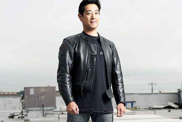 Grant Imahara poses atop M5 for a Discovery Channel photo shoot in August 2007.