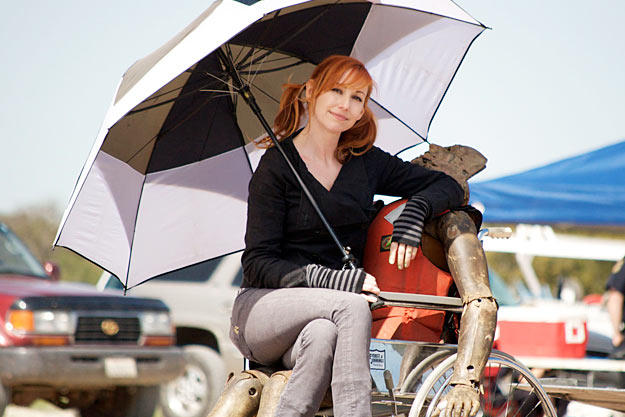 Kari Byron cozies up to Buster during the filming of Fireworks Man in 2010.