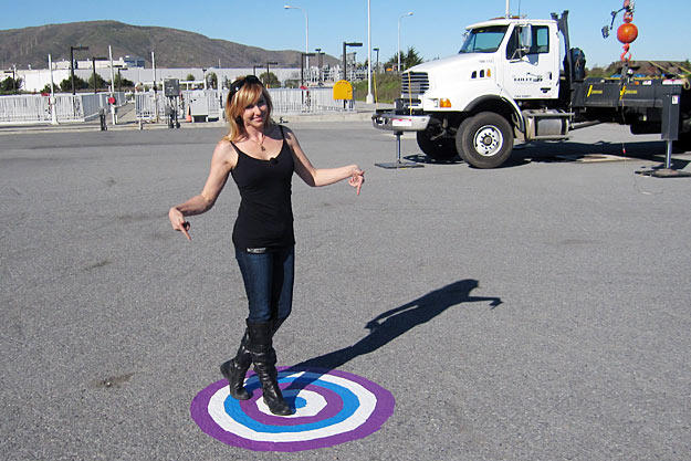 """Kari Byron shows off the saucy target painted just for Buster in the """"Water = Pavement"""" test."""