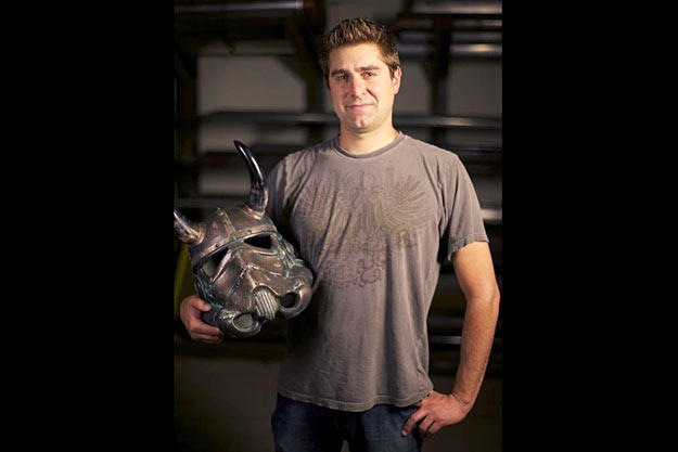 Tory Belleci poses with the customized Stormtrooper helmet he created for the 501ST TK PROJECT. Tory's Viking Helmet is one of more than 50 unique and artistically-modified Stormtrooper helmets that was displayed and auctioned off during