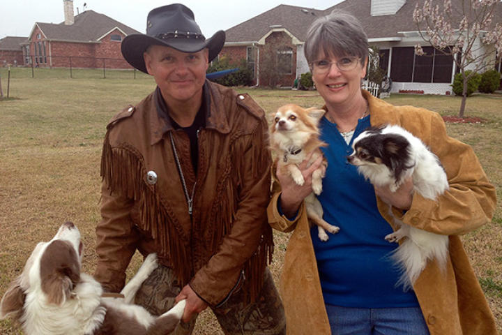 Ernie Brown, Jr., the Turtleman, and homeowner Linda Jangula pose with their beloved canine companions.