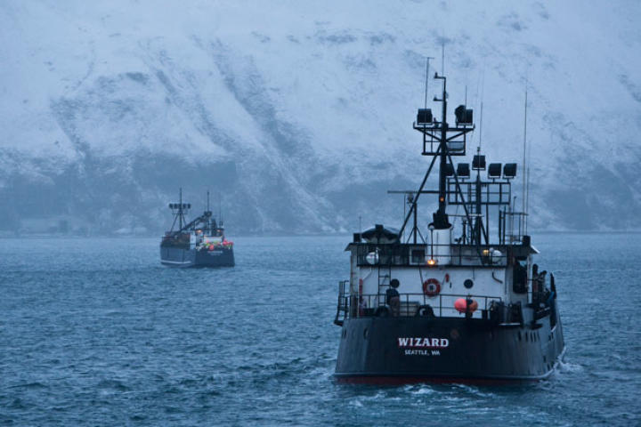 The Kodiak and Wizard head out to the open sea past the snow-covered mountains that ring Dutch Harbor.