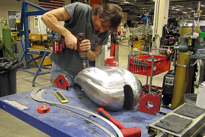 Rick Petko works on the gas tank for Orange County Choppers' Hard Rock Bike. There were some issues between the design on paper and the fabrication in reality, as revealed in the Chopper Aftershow.