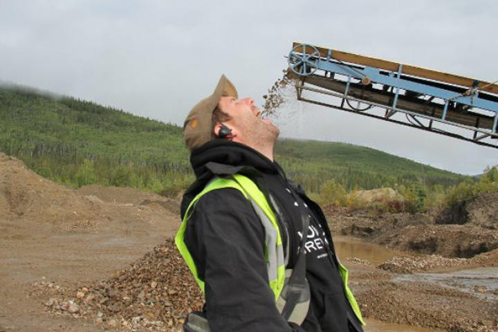Crew member Ronan Browne opens wide for Quartz Creek tailings.