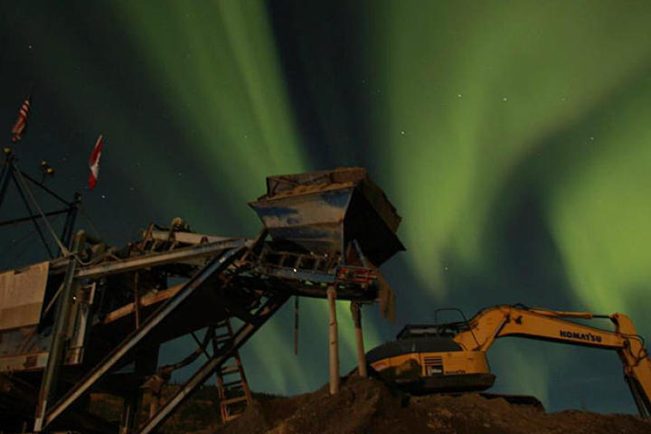 The Northern Lights fill the sky over the Hoffman's wash plant.