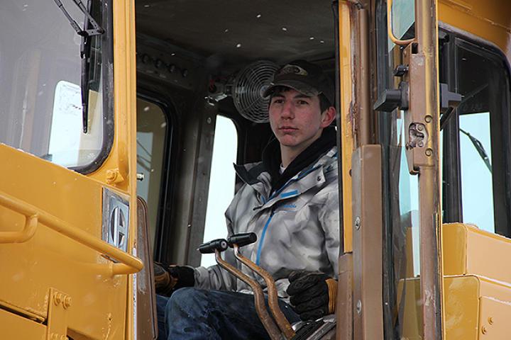 Parker in an excavator.