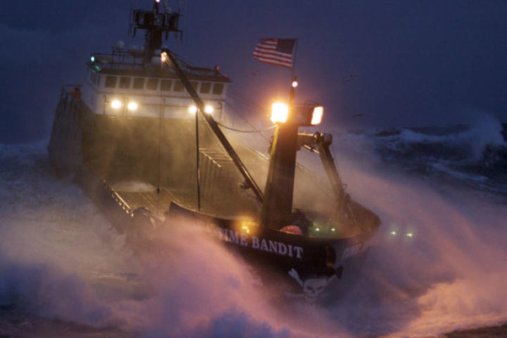 The Time Bandit powers through heavy seas — with her sodium high beams lighting the way.