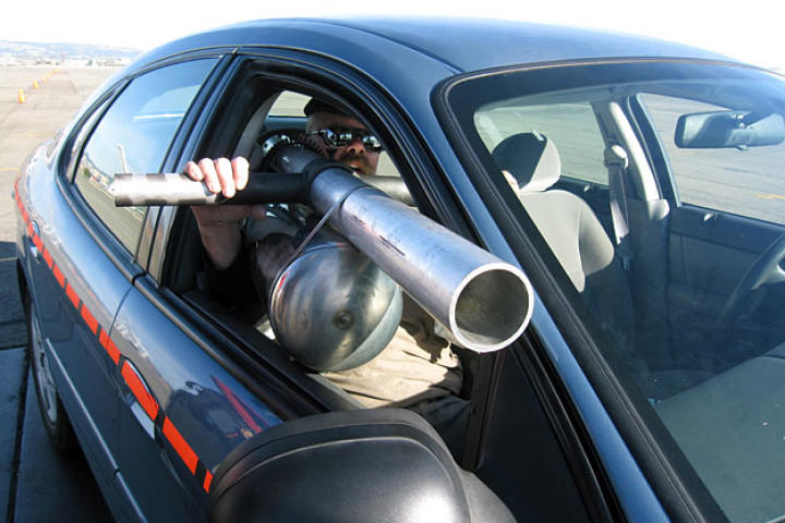 In order to test whether tossing a cup out a speeding car's window can injure or kill another driver, Jamie Hyneman built a shoulder-mounted soda-can cannon. Naturally.