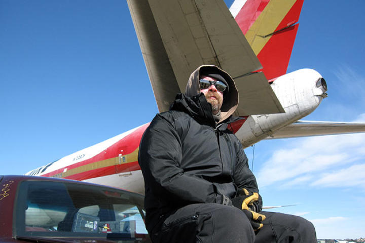 Jamie Hyneman sits below the MythBusters' tornado simulator, a 747 that is capable of blasting out thrust at over 180,000 pounds.