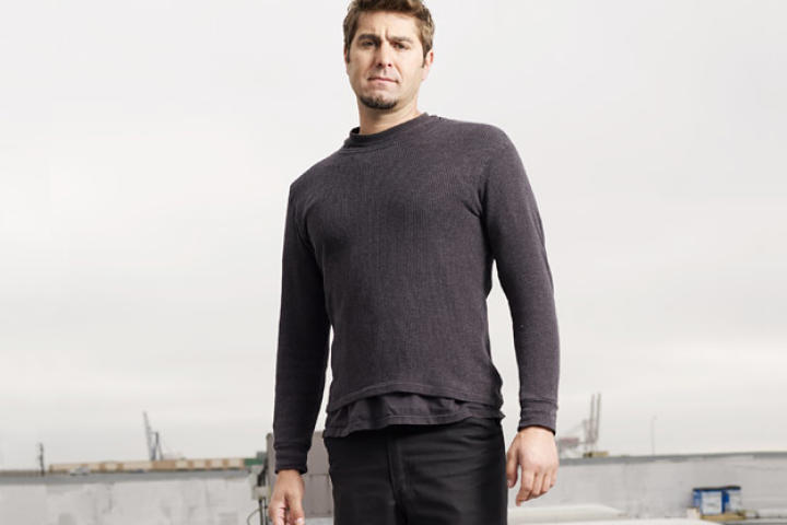 Tory Belleci poses on the roof of M5 for an August 2007 Discovery Channel photo shoot.