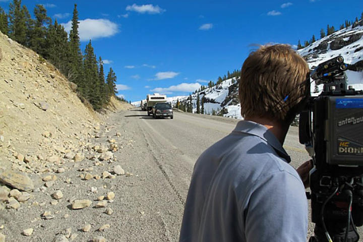 Jamie Berry, the producer-director for the first episodes of Gold Rush, films the miners' convoy along an Alaskan highway during the last leg of their journey to Porcupine Creek. Getting film crews in position at the right times along the route from Oregon to Alaska proved to be the first big challenge faced by the production team.