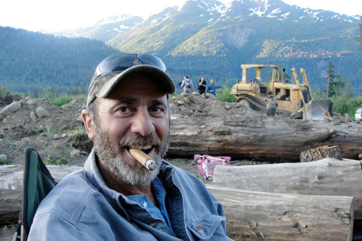 Good-natured Chris Doumitt likes nothing better than a fine cigar with a great view.