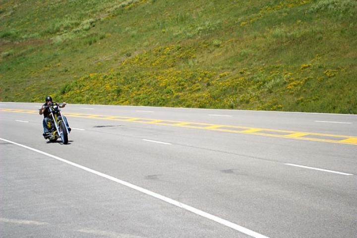Paul Teutul Sr. rides the ESAB Bike.